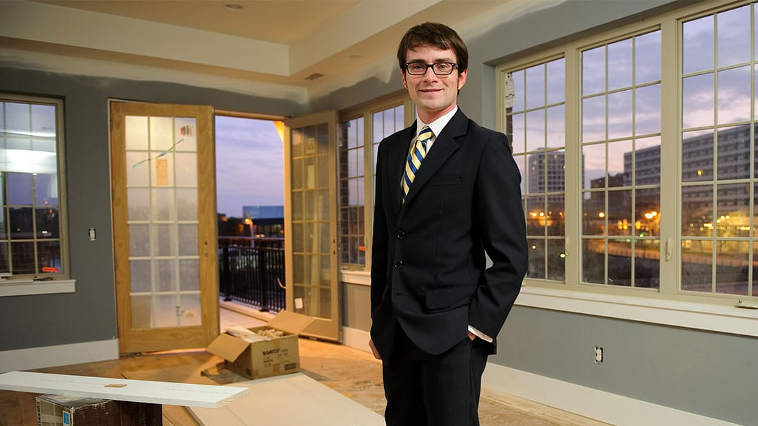 David Matthews standing in East Bank Townhome